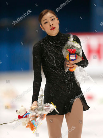 South Korea's Kim Yu-Na holds flowers after performing in the free skating of the Golden Spin figure skating competition in Zagreb, Croatia