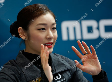 South Korea's Kim Yu-Na reacts after seeing results, which place her first, in the free skating of the Golden Spin figure skating competition in Zagreb, Croatia