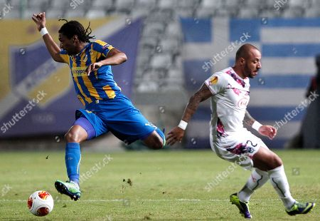 Helder Cebral, Julien Faubert Helder Cebral, left, of Apoel Nicosia fights for the ball with Julien Faubert, right, of Bordeaux, France, during their Europa League group F soccer match at GSP stadium in Nicosia, Cyprus