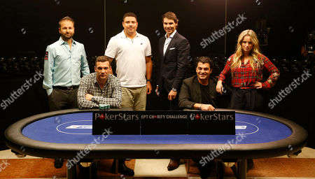 Canadian poker professional Daniel Negreanu, former Ukranian soccer player Andriy Schevchenko, former Brazilian soccer player Ronaldo, Spanish tennis player Rafael Nadal, former Italian skier Alberto Tomba and former Dutch field hockey player Fatima Moreiro de Melo, from left to right, pose for a photograph before attending a celebrity charity poker tournament in Prague, Czech Republic