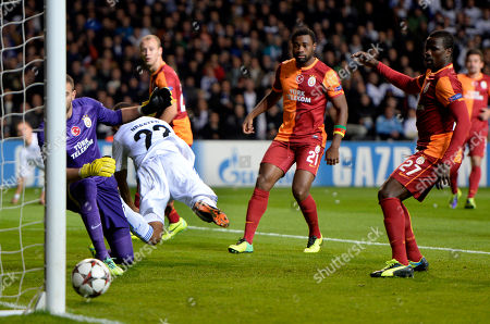 Denmark Soccer Champions League Galatasaray AS's goalkeeper Eray Iscan, left, Aurelien Chedjou of Cameroon, second right, and Emmanuel Eboue of Ivory Coast, right, looks as FC Copenhagen's Daniel Braaten of Norway, 2nd left, scores the opening goal with his heel during their Champions League Group B soccer match at Parken Stadium, Copenhagen, Denmark