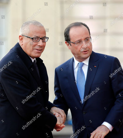 Libyan Prime Minister Ali Zeidan, left, is greeted by French President Francois Hollande at the Elysee Palace, in Paris, . France is hosting dozens of African leaders for a summit on security, just as the French military is launching an intervention in the Central African Republic and encouraging African governments to take more responsibility for peacemaking on the continent