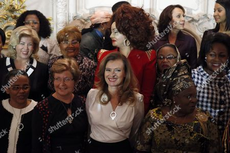 French President Francois Hollande's companion Valerie Trierweiler, center, poses with, from left bottom, Ethiopia's first lady Roman Tesfaye Abneh, European Council President's wife Geertrui Van Rompuy, and Nigeria's first lady Patience Jonathan, right, on second row, from left, Ivory Coast's first lady Dominique Ouattara, Burkina Faso first lady Chantal Compaore, and Cameroon's first lady Chantal Biya, Comoros Islands first lady Hadidja Aboubacar Ikililou Dhoinine, Congo's first lady Antoinette Sassou Nguesso, and in the back at right, Gabon's first lady Sylvia Bongo Ondimba and Gambia's first lady Zineb Yahya Jammeh during a photo opportunity, at a meeting dubbed 'The Mobilisation against sexual violence towards women in conflict' attended by the first ladies of African nations, held alongside the Summit for Peace and Security in Africa, at the Musee d'Orsay, in Paris, . France is hosting dozens of African leaders for a summit on security, just as the French military is launching an intervention in the Central African Republic and encouraging African governments to take more responsibility for peacemaking on the continent