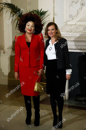 French President Francois Hollande's companion Valerie Trierweiler, right, greets Cameroon's First Lady Chantal Biya, left, as she arrives for a meeting dubbed 'The Mobilisation against sexual violence towards women in conflict' attended by the first ladies of African nations, held alongside the Summit for Peace and Security in Africa, at the Musee d'Orsay, in Paris, . France is hosting dozens of African leaders for a summit on security, just as the French military is launching an intervention in the Central African Republic and encouraging African governments to take more responsibility for peacemaking on the continent