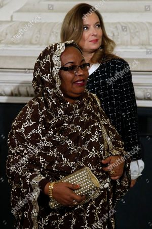 French President Francois Hollande's companion Valerie Trierweiler, back, looks, as Comoros Islands First Lady Hadidja Aboubacar Ikililou Dhoinine arrives for a meeting dubbed 'The Mobilisation against sexual violence towards women in conflict' attended by the first ladies of African nations, held alongside the Summit for Peace and Security in Africa, at the Musee d'Orsay, in Paris, . France is hosting dozens of African leaders for a summit on security, just as the French military is launching an intervention in the Central African Republic and encouraging African governments to take more responsibility for peacemaking on the continent