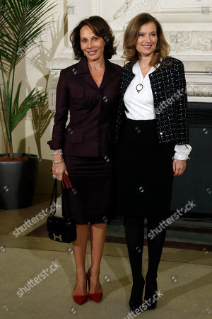 Stock Photo of French President Francois Hollande's companion Valerie Trierweiler, right, greets Gabon's First Lady Sylvia Bongo Ondimba, left, as she arrives for a meeting dubbed 'The Mobilisation against sexual violence towards women in conflict' attended by the first ladies of African nations, held alongside the Summit for Peace and Security in Africa, at the Musee d'Orsay, in Paris, . France is hosting dozens of African leaders for a summit on security, just as the French military is launching an intervention in the Central African Republic and encouraging African governments to take more responsibility for peacemaking on the continent