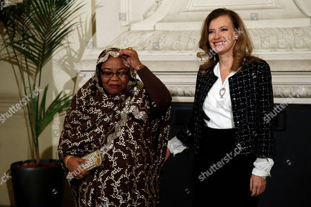 French President Francois Hollande's companion Valerie Trierweiler, right, poses with Comoros Islands First Lady Hadidja Aboubacar Ikililou Dhoinine, left, as she arrives for a meeting dubbed 'The Mobilisation against sexual violence towards women in conflict' attended by the first ladies of African nations, held alongside the Summit for Peace and Security in Africa, at the Musee d'Orsay, in Paris, . France is hosting dozens of African leaders for a summit on security, just as the French military is launching an intervention in the Central African Republic and encouraging African governments to take more responsibility for peacemaking on the continent