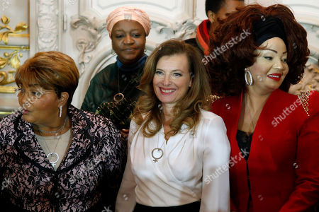 French President Francois Hollande's companion Valerie Trierweiler, center, poses with, from left, Burkina Faso First Lady Chantal Compaore, Special Representative of the United Nations Secretary General on Sexual Violence in Conflict Zainab Hawa Bangura, and Cameroon's First Lady Chantal Biya, right, during a family photo at a meeting dubbed 'The Mobilisation against sexual violence towards women in conflict' attended by the first ladies of African nations, held alongside the Summit for Peace and Security in Africa, at the Musee d'Orsay, in Paris, . France is hosting dozens of African leaders for a summit on security, just as the French military is launching an intervention in the Central African Republic and encouraging African governments to take more responsibility for peacemaking on the continent