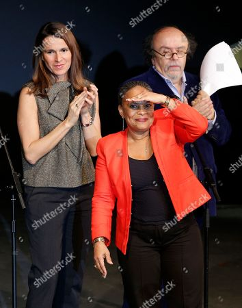 French Culture Minister Aurelie Filippetti, left, French Justice Minister Christine Taubira, center, and theatre Director Jean-Michel Ribes attend a gala ceremony against racism, in Paris, . The French government has opened a racism investigation after a far-right magazine cover compared the country's black justice minister to a monkey
