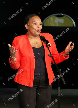 French Justice Minister Christine Taubira delivers her speech during a gala ceremony against racism, in Paris, . The French government has opened a racism investigation after a far-right magazine cover compared the country's black justice minister to a monkey