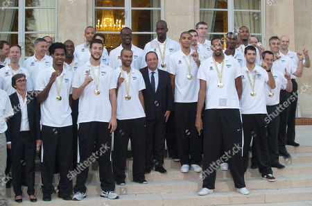 Valerie Fourneyron, Francois Hollande French Sport Minister Valerie Fourneyron, left, and French President Francois Hollande, center, pose for a group photo with the French basketball team at the Elysee Palace in Paris, . France won its first major basketball title by beating Lithuania 80-66 in the final of the European championship on Sunday, Sept. 22, 2013