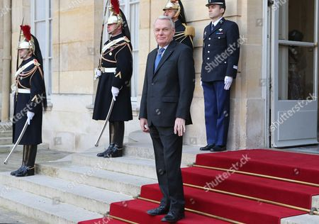 French Prime Minister Jean-Marc Ayrault waits on the front steps of the Hotel Matignon. prior to welcome his, Quebec Prime Minister Pauline Marois before their meeting in Paris