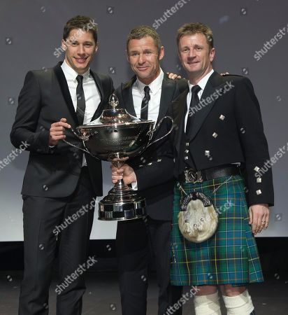 Stock Image of Loic Duval, Tom Kristensen, Allan McNish 2013 Endurance world champion, from left, Loic Duval of France, Tom Kristensen of Denmark and Allan McNish of Scotland hold the trophy during the FIA Prize-Giving gala in Saint Denis, outside Paris
