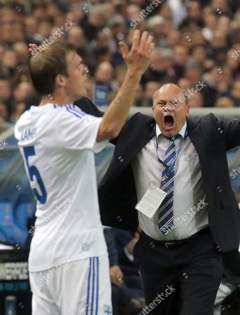Finish head coach Mixu Paatelainen, right, reacts as he watches his player, Veli Lampi, during their group I World Cup qualifying soccer match between France and Finland, at the Stade de France stadium in Saint Denis, outside Paris