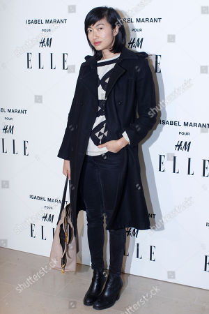 Misty Rabbit poses for photographers as she arrives to the launch of Isabel Marant for H&M collection, in Paris