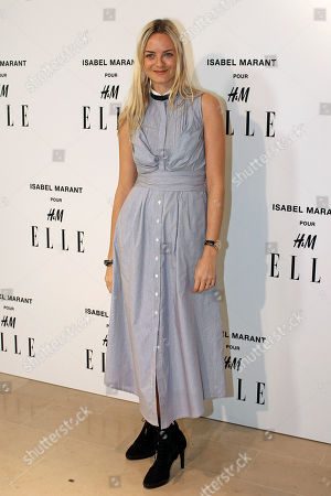 Virginie Courtin Clarins poses for photographers as she arrives to the launch of Isabel Marant for H&M collection, in Paris