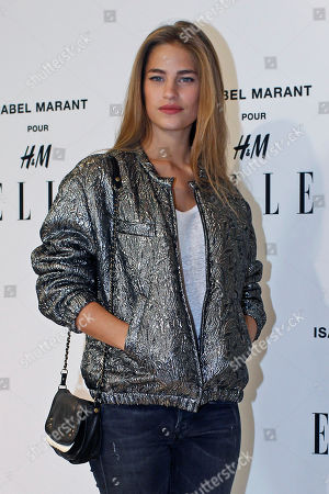 French actress Solene Hebert poses for photographers as she arrives to the launch of Isabel Marant for H&M collection, in Paris