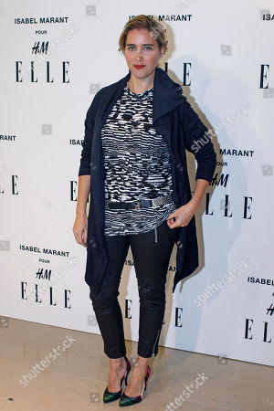 Vahina Giocante poses for photographers as she arrives to the launch of Isabel Marant for H&M collection, in Paris