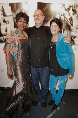 Stock Image of Euzhan Palcy, film director, writer and producer from the French West Indies, left, Israeli composer Armand Amar, center, and Algerian actress Biyouna pose for photographers as they arrive for Extravagant India!, the international Indian Film Festival in Paris