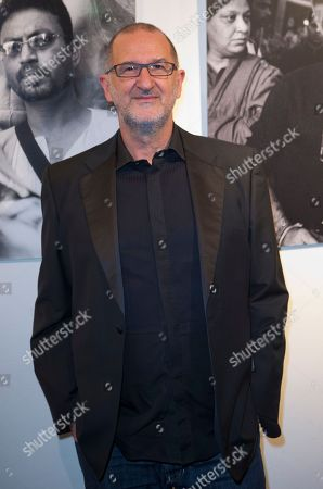 Stock Picture of Israeli composer Armand Amar poses for photographers as he arrives for Extravagant India!, the international Indian Film Festival in Paris