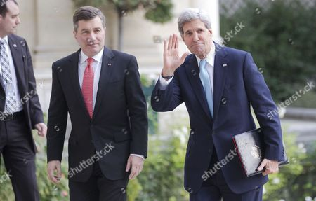 John Kerry U.S. Secretary of State John Kerry, right, waves to the media as he and U.S. ambassador to France Charles H. Rivkin, left arrive at the U.S. embassy for a meeting with the Arab League in Paris, . Kerry is in Paris for diplomatic talks about a peace process for Israel and Palestinian authorities
