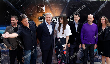 "Left to right, U.S Producer Bob Orci, U.S Producer Gavin Hood, U.S actor Harrison Ford, U.S actress Hailee Steinfel, U.S actor Asa Butterfield, Sir Ben Kingsley and U.S Director Gigi Pritzker pose for photographers during a photo call for the film "" La Strategie Ender"", (Enders Game) in Paris"