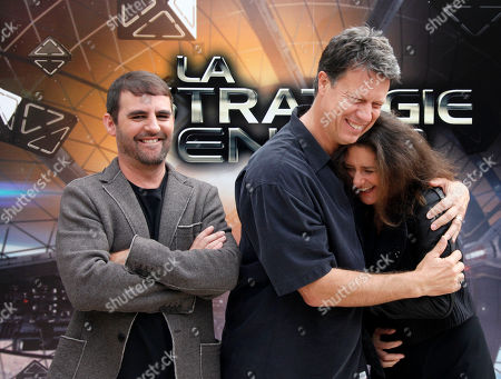 """Left to right, U.S Producer Bob Orci, U.S Producer Gavin Hood and U.S Director Gigi Pritzker pose for photographers during a photo call for the film """" La Strategie Ender"""", (Enders Game) in Paris"""