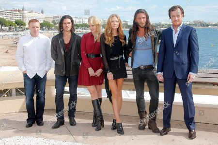 """From left, producer Jon Steinberg, actors Luke Arnold, Hannah New, Clara Paget, Zach McGowan and Toby Stephens, pose during a photo call at the 29th MIPCOM, International Film and Programme Market for Tv, Video,Cable and Satellite, in Cannes, south eastern France, . The actors attended MIPCOM to promote the TV series """" Black Sails"""