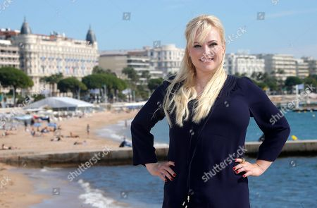"""Stock Image of American columnist, author and blogger Meghan McCain poses during photocall at the 29th MIPCOM (International Film and Programme Market for TV, Video, Cable and Satellite) in Cannes, southeastern France, . Meghan McCain attends Mipcom to promote a genre-busting docu-talk series, """"Raising McCain"""" where she is the host. Meghan Mccain is a daughter of U.S. Senator John McCain and Cindy Hensley McCain"""