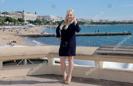 """Stock Photo of American columnist, author and blogger Meghan Mccain poses during photocall at the 29th MIPCOM (International Film and Programme Market for Tv, Video,Cable and Satellite) in Cannes, southeastern France, . Meghan Mccain presents at the Mipcom, a genre-busting docu-talk series, """"Raising McCain"""" where she is the host. Meghan Mccain is a daughter of U.S. Senator John McCain and Cindy Hensley McCain"""