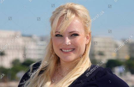 """American columnist, author and blogger Meghan Mccain poses during photocall at the 29th MIPCOM (International Film and Programme Market for TV, Video, Cable and Satellite) in Cannes, southeastern France, . Meghan Mccain attends Mipcom to promote a genre-busting docu-talk series, """"Raising McCain"""" where she is the host. Meghan Mccain is a daughter of U.S. Senator John McCain and Cindy Hensley McCain"""
