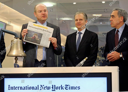 Stock Photo of New York Times company chief executive officer Mark Thompson, left, displays a copy of the International New York Times, at the opening of Euronext quotations, in Paris, . The New York Times Co. has rebranded its Paris-based daily, the International Herald Tribune, as the International New York Times - a bid to lure readers abroad amid the upheaval of the digital era facing traditional newspapers. Arthur Ochs Sulzberger Jr. chairman of the board of the New York Times Company, stands centre right, next to Michael Golden vice chairman of the Nerw York Times Company