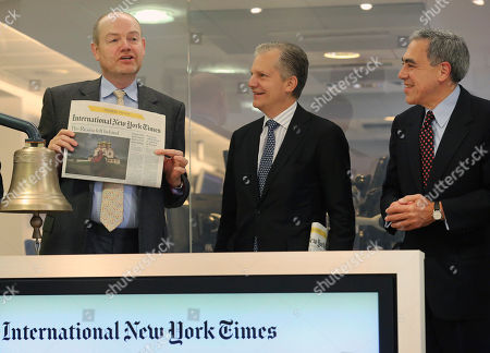 Stock Image of Arthur Ochs Sulzberger Jr., Michael Golden, Mark Thompson New York Times company chief executive officer Mark Thompson shows the first issue of the International New York Times, after ringing the bell at the opening of Euronex quotations, in Paris, . The New York Times Co. is rebranding its Paris-based daily, the International Herald Tribune, as the International New York Times - a bid to lure readers abroad amid the upheaval of the digital era facing traditional newspapers. Watching at right are Arthur Ochs Sulzberger Jr. chairman of the board of the New York Times Company, and Michael Golden vice chairman of the New York Times Company