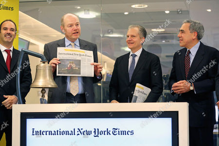 Stock Photo of New York Times company chief executive officer Mark Thompson, second left, displays an issue of the International New York Times, at the opening of Euronext quotations, in Paris, . The New York Times Co. has rebranded its Paris-based daily, the International Herald Tribune, as the International New York Times - a bid to lure readers abroad amid the upheaval of the digital era facing traditional newspapers. Other people in photo, from left, NYSE Euronext deputy director of the International Listings Department Nathanael Mauclair, Arthur Ochs Sulzberger Jr. chairman of the board of the New York Times Company, Michael Golden vice chairman of the Nerw York Times Company, and President of the International New York Times Stephen Dunbar-Johnson