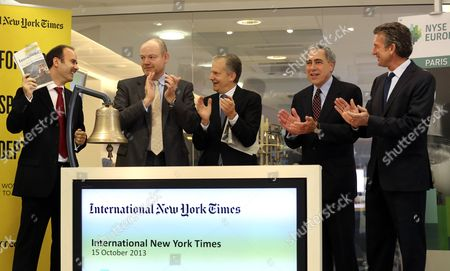 Stock Picture of New York Times company chief executive officer Mark Thompson, second from left, applauds at the ring the bell ceremony at the opening of Euronex quotations, in Paris, . The New York Times Co. has rebranded its Paris-based daily, the International Herald Tribune, as the International New York Times - a bid to lure readers abroad amid the upheaval of the digital era facing traditional newspapers. Other from left, NYSE Euronext deputy director of the International Listings Department Nathanael Mauclair, Arthur Ochs Sulzberger Jr. chairman of the board of the New York Times Company, Michael Golden vice chairman of the Nerw York Times Company, and President of the International New York Times Stephen Dunbar-Johnson