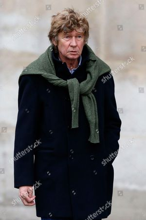Stock Photo of French film Director Etienne Chatiliez leaves after a Memorial ceremony for Patrice Chereau at Saint Sulpice Church in Paris, France, . Patrice Chereau, a celebrated and award-winning French actor and director in film, theater and opera who was renowned for cutting-edge productions, has died, officials said Tuesday Oct. 8, 2013 at age 68
