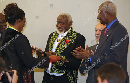 Ousmane Sow, Marieme Faye, Abdou Diouf Senegalese sculptor Ousmane Sow, center, receives his academic sword from Marieme Faye, left, wife of Senegal's President Macky Sall, as former Senegalese President Abdou Diouf, right, applauds, during a ceremony at the French Academy in Paris, . Ousmane Sow is the first African to be enthroned at the French Beaux Arts Academy