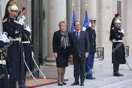 Francois Hollande, Pauline Marois French President Francois Hollande, right, poses for photographers with Quebec's Prime Minister Pauline Marois, prior to their meeting at the Elysee Palaece in Paris