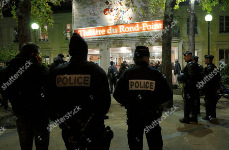 French policemen stand guard in front of the Theatre du Rond Point in Paris, during a gala ceremony against racism, after demonstrators protested against gay marriage supporter French Justice Minister Christine Taubira