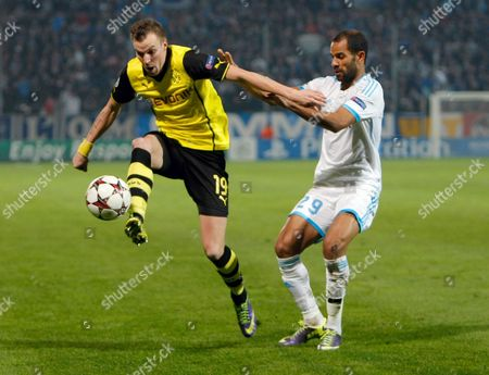 Dortmund's Kevin Grosskreutz, left, controls the ball while Marseille's Saber Khalifa looks on during the Group F Champions League soccer match between Olympique Marseille and Borussia Dortmund at the Velodrome stadium in Marseille, Southern France