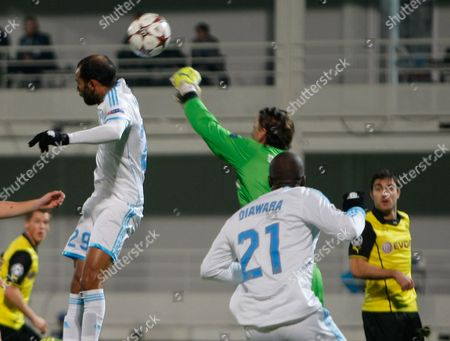 Dortmund goalkeeper Roman Weidenfeller, 2nd right, and Marseille's Saber Khalifa, left, jumps for the ball while Marseille's Souleymane Diawara looks, right, during the Group F Champions League soccer match between Olympique Marseille and Borussia Dortmund at the Velodrome stadium in Marseille, Southern France