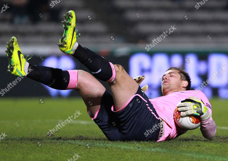 Stock Image of Cedric Carrasso Bordeaux's goalkeeper Cedric Carrasso stops the ball during the Europa League group F soccer match against Frankfurt in Bordeaux, southwestern France, Thursday, Oct.24, 2013