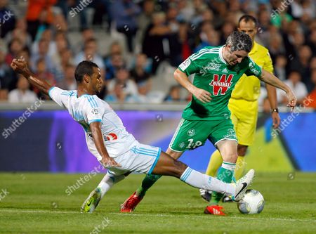 Fabien Lemoine, Jacques-Alaixys Romao Saint-Etienne's French midfielder Fabien Lemoine, right, challenges for the ball with Marseille's Togolese midfielder Jacques-Alaixys Romao, during their League One soccer match, at the Velodrome Stadium, in Marseille, southern France