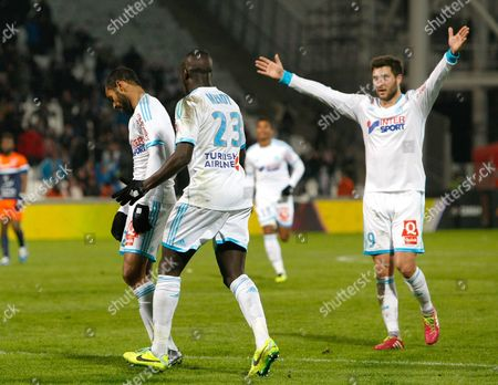 Marseille's Tunisian forward Saber Khalifa, left, reacts with French defender Benjamin Mendy, center, and French forward Andre-Pierre Gignac, after scoring against Montpellier, during their League One soccer match, at the Velodrome Stadium, in Marseille, southern France