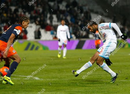 Saber Khalifa, Daniel Congre Marseille's Tunisian forward Saber Khalifa, right, scores against Montpellier, despite Montpellier' s defender Daniel Congre, during their League One soccer match, at the Velodrome Stadium, in Marseille, southern France