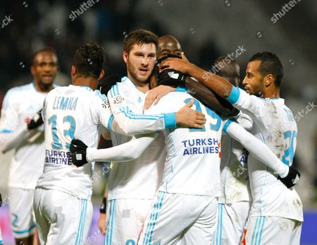 Saber Khalifa, Andre-Pierre Gignac Marseille's Tunisian forward Saber Khalifa, center, reacts with Marseille's French forward Andre-Pierre Gignac, third left, and his teammates, after scoring against Montpellier, during their League One soccer match, at the Velodrome Stadium, in Marseille, southern France