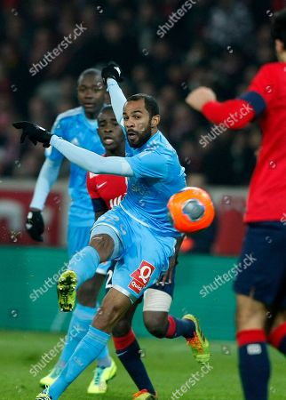 Marseille's Saber Khalifa, center, attempts a shot during his French League one soccer match at the Lille Metropole stadium, in Villeneuve d'Ascq, northern France