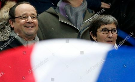 French President Francois Hollande, left, and sports minister Valerie Fourneyron attends the World Cup qualifying playoff second-leg soccer match between France and Ukraine at Stade de France stadium in Saint Denis, outside Paris, . France beats Ukraine 3-0 in playoff second leg to qualify for World Cup
