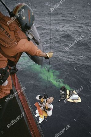 Edwin E. Aldrin Jr. (Buzz), and James A. Lovell Jr, pictures with space capsule in the water and the helicopter recovery of the astronauts, shown in an undated photo