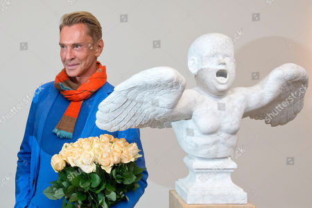 Wolfgang Joop The fashion designer and artist Wolfgang Joop stands behind a sculpture during the opening event of the exhibition 'Beauty and the Beast - Richard Mueller and Mel Ramos at the Museum of the Fine Arts (Museum der bildenden Kuenste) in Leipzig, central Germany, . The exhibition starts on Oct. 13, 2013 and last until Jan. 12, 2014